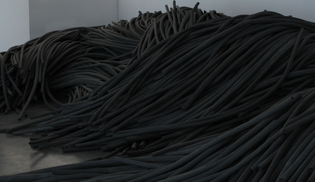 KERNEL (Pegy Zali, Petros Moris, and Theodoros Giannakis), Torrent, 2016. Disposed plastic cable jackets, dimensions variable. Courtesy the artist